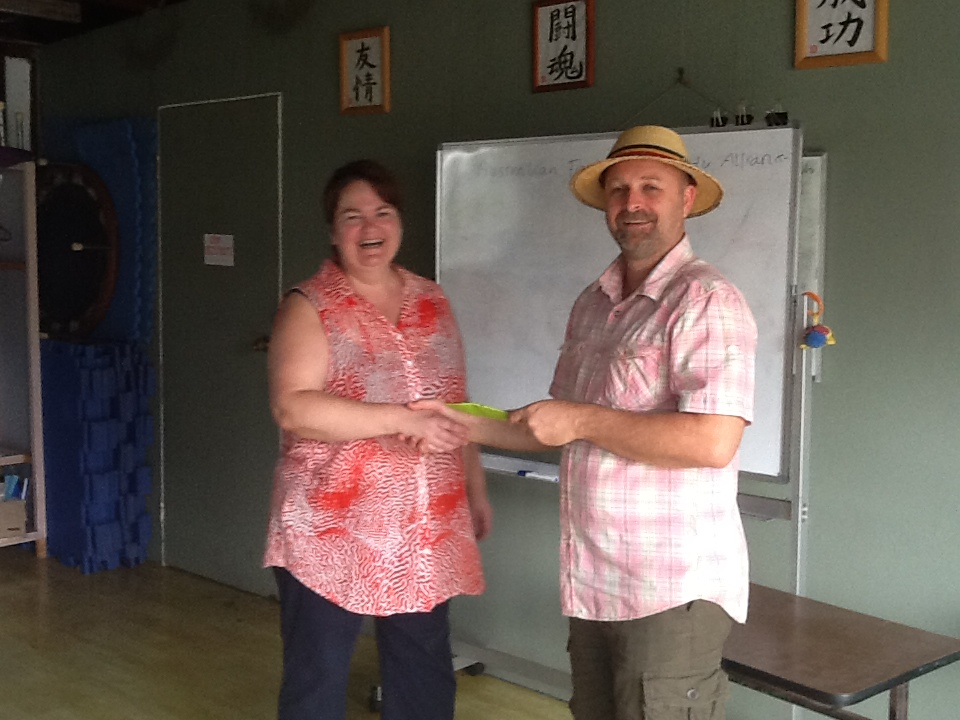Green Dean presenting Dr Carol Richards, AFSA Committee member, with a cheque for $550
